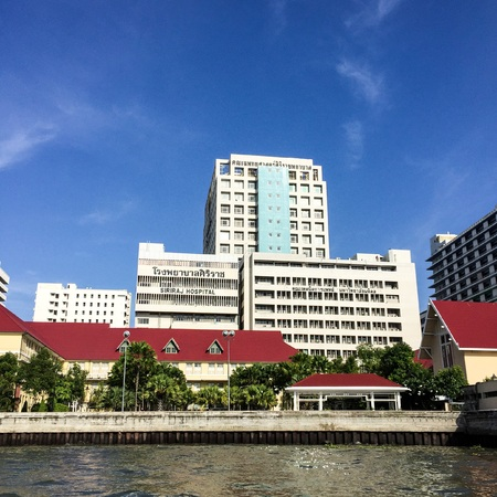 west river: Bangkok, Thailand - August 9, 2016: Siriraj hospital is the first hospital and medical school in Thailand, located at the West bank of Chao Phaya river in Bangkok.