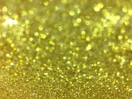 defocus: Abstract gold bokeh circles for christmas background, glitter light defocused and blurred bokeh. Stock Photo