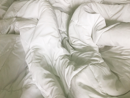 bed sheet: Close up of white bedding sheets and empty space.