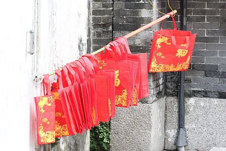 MACAU, CHINA %u2013 DECEMBER 16, 2017 : Red paper bag hanging for wait to dry color. Editorial