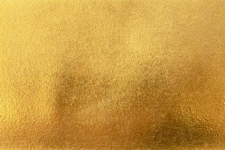 Ombra astratta del fondo o di struttura e di pendenze dell'oro. Archivio Fotografico