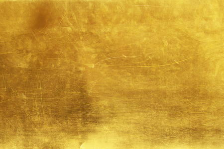 Gold abstract background or texture distress  scratch and gradients shadow. Reklamní fotografie