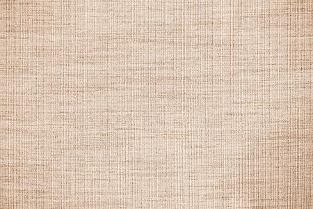 Trama o sfondo del tessuto di lino marrone