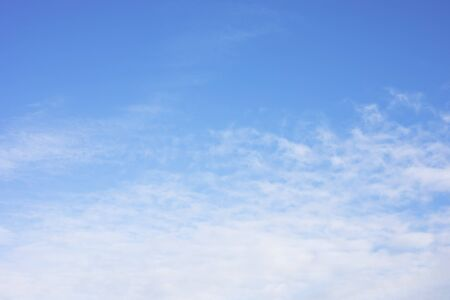 Blue sky background and white clouds soft focus, and copy space. Reklamní fotografie