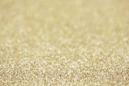 Gold sparkle glitter for Christmas background.