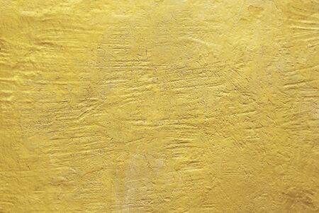 Gold abstract concrete wall background or texture
