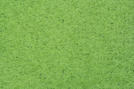 Green fake grass texture or background and copy space