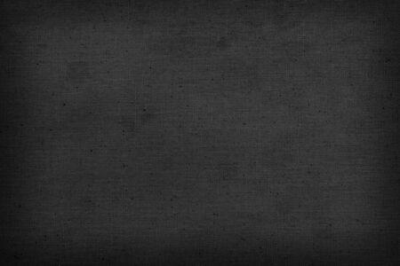Zwarte oude linnen stof textuur of achtergrond en kopieer ruimte