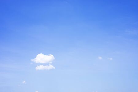 Blue sky background and white clouds soft focus, and copy space. 写真素材