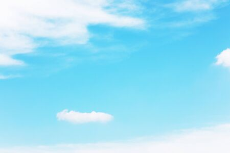 Blue sky background and white clouds soft focus, and copy space. Imagens