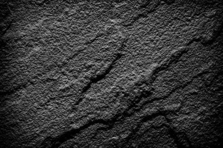 Dark gray black slate stone background or texture