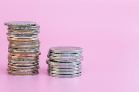 Silver coins on the pink background