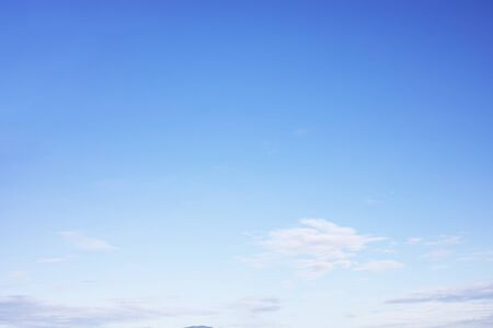 Blue sky background and soft white clouds, copy space.