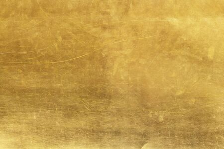 Gold abstract background or texture distress  scratch and gradients shadow. Imagens