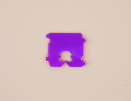 Ring plastic for bundle bag bread on light brown background Imagens