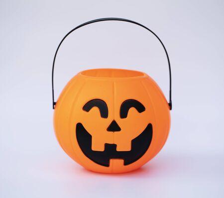 orange pumpkin face smile on white background, symbol halloween 写真素材