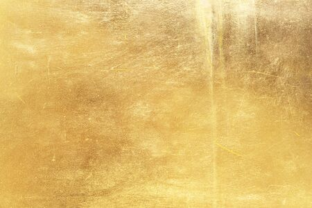 Gold abstract background or texture distress  scratch and gradients shadow. 写真素材