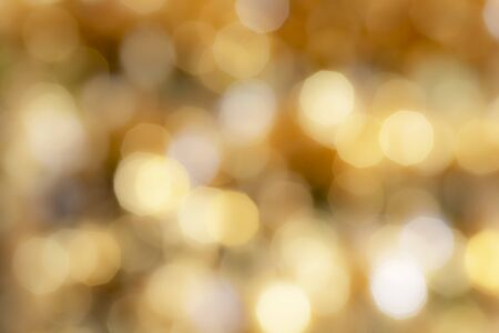 Gold sparkle glitter and copy space for Christmas background.