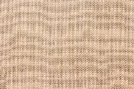 Brown linen fabric texture or background.