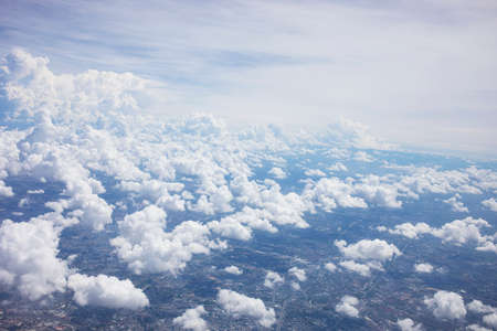 Blue sky background and white clouds soft focus, top view take a picture on airplane