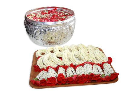 a group of Thai garland flowers and water with jasmine and roses corolla in bowl isolated on white background, use for Songkran festival in Thailand