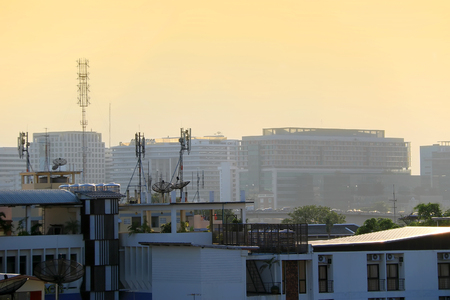 top view of urban with parabolic satellite dishes on rooftops