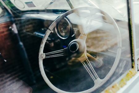 Steering wheel and a dash board of an old retro car