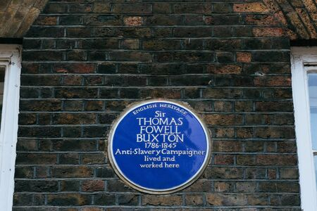 Blue plaque installed on a Brick Lane to commemorate a link between location and Sir Thomas Fowell Buxton Editorial