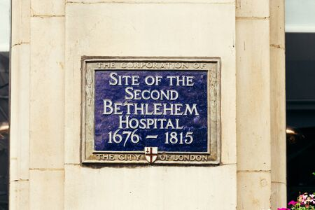 London, UK - July 22, 2018: Blue plaque installed to commemorate a link between location and Bethlehem Hospital. It moved outside of Moorfields in the 17th century