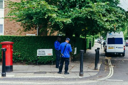 London, UK - July 30, 2018: Parking enforcement officers working on the Acol Road in West Hampstead,  London Borough of Camden, UK Editoriali