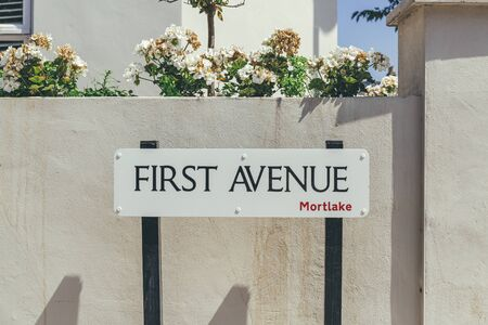 First Avenue name sign in Mortlake, suburban district in the London Borough of Richmond upon Thames, UK
