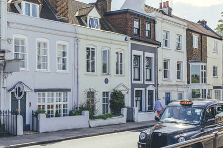 London/UK-1/08/18: Ninette de Valois's house at 14 The Terrace, Barnes, facing the river, with English Heritage blue plaque,
