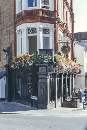 London/UK-1/08/18: The Railway Tavern, a traditional public house on The Quadrant in Richmond. Pubs are a social drinking establishment and a prominent part of British culture Editorial