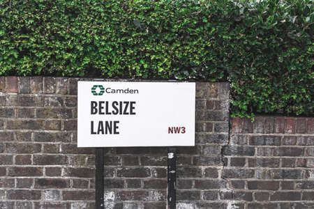 Belsize Lane name sign near Swiss Cottage, London Borough of Camden, Hampstead, London, UK. The name is derived from French bel assis meaning 'well situated'