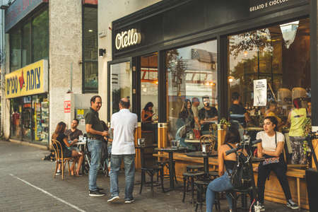 Tel Aviv/Israel-12/10/18: people socializing in the Otello gelateria on Dizengoff Street in Tel Aviv