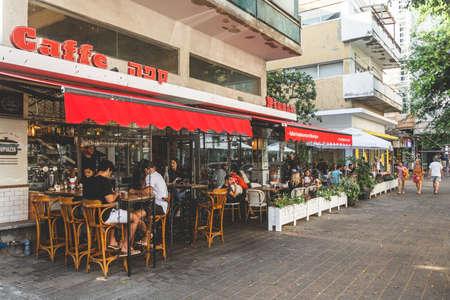 Tel Aviv/Israel-13/10/18: people sitting in an outdoor sitting area of the Soupizza restaurant on Dizengoff Street in Tel Aviv