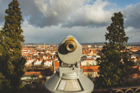 Coin-operated binoculars on the viewing platform of the Michelsberg monastery in Bamberg, Germany