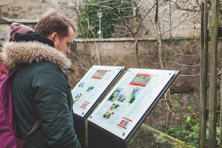 Rothenburg/Germany-1/1/19: Tourists reading a description on the information board in the Old town of Rothenburg ob der Tauber, a well-known destination for tourists from around the world