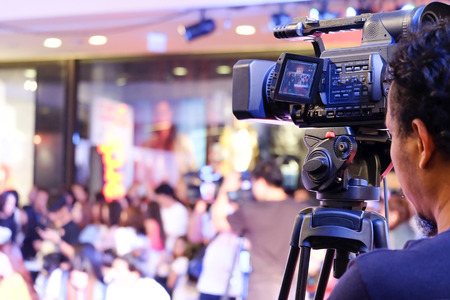 Covering an event with a video camera Banco de Imagens
