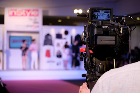 Covering an event with a video camera Archivio Fotografico