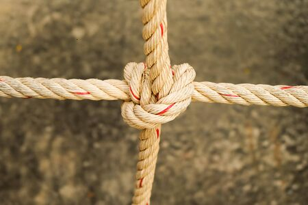 tied in: Rope tied in a knot Stock Photo
