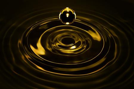 金液の滴が暗闇の中でクローズ アップ