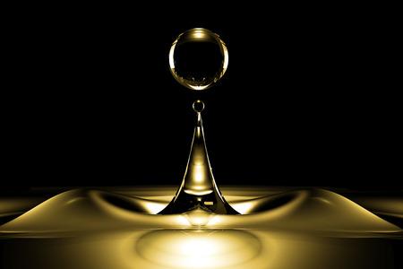 Drops of liquid gold close up in the dark Reklamní fotografie - 52398844