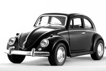 vw: Volkswagen VW beatle in Black  toy model car on white background