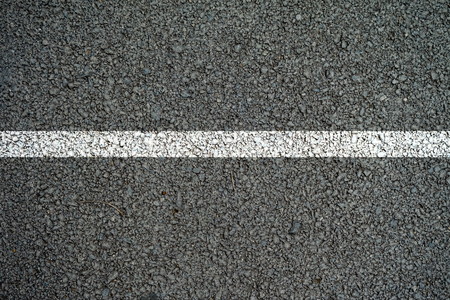 road surface: The lines on the asphalt road surface.