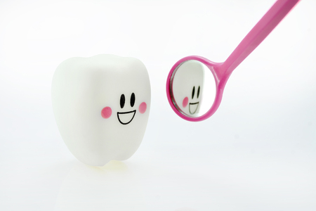smiling teeth toy emotion with dental mirror Banco de Imagens