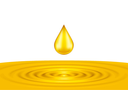 Drops of liquid gold close up on the white background