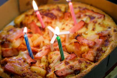 Pizza with candles to celebrate a birthday ,with selective focus