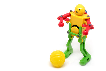 de focus: Toy Robot Are playing football, sport concept.