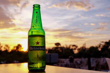 Chiang Mai, Thailand - August 1, 2016: Heineken beer on the table during sunset. The atmosphere is ideal for celebrations and relaxation. Editorial